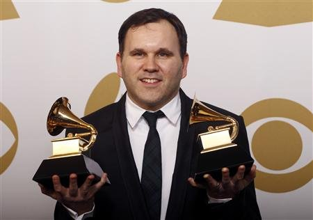 An all-dressed-up Matt Redman collects two pieces of hardware at the 2013 Grammy Awards
