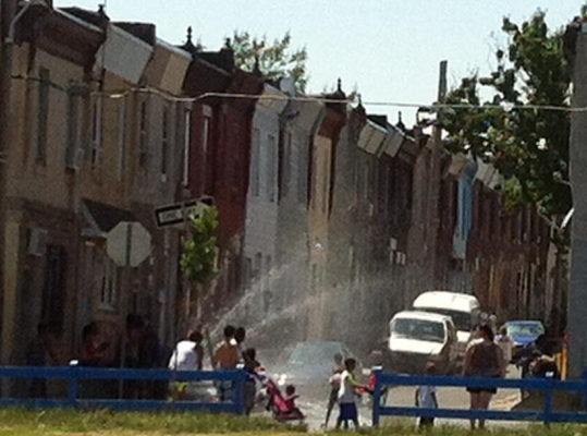 This is a picture Shane Claiborne posted on Twitter of the community where The Simple Way ministers in Philadelphia: Sprinklers open for cooling on a hot day