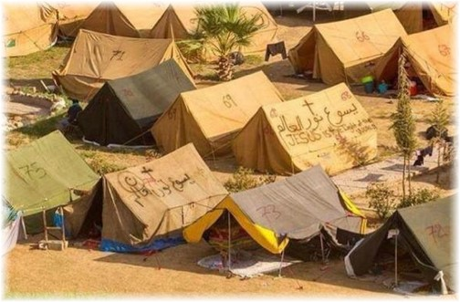"From DailyEncouragement.net -- ""...It is a camp for displaced Christian refugees in Iraq (Click to enlarge). Note the English on the center tent proclaiming in a very dark place, 'Jesus Is The Light Of The World'."""