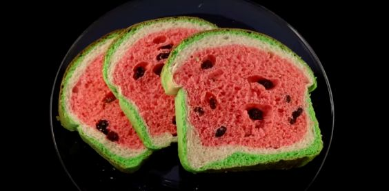 I left getting the upper image to the last minute, so you'll have to settle for this picture of watermelon shaped raisin bread. Click the image to watch the instruction video.