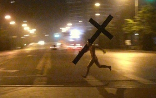 I think this guy is late for the evening service. He may not have his Bible, but he remembered his cross.