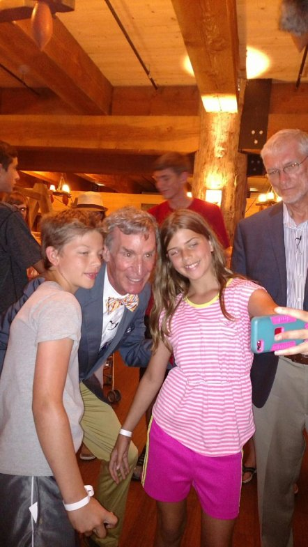 Ken Ham watches from the sidelines as kids take a selfie with Bill Nye the Science Guy at the Ark Encounter.