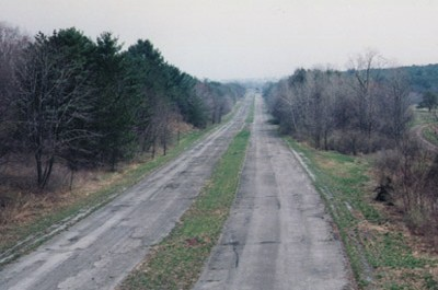 Section of highway photographed several years after the world ended.